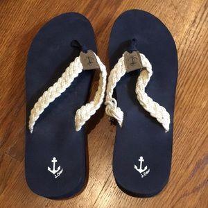 Platform flip flops; navy with white rope braid